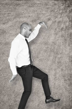 Businessman stepping against grey background