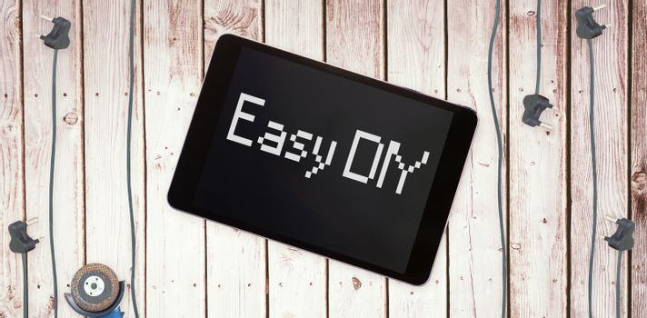 Easy diy against tablet pc on wooden surface