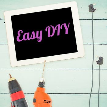 Easy diy against tools and tablet on wooden background