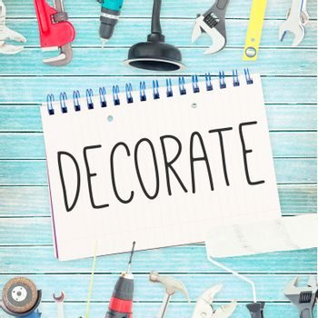 Decorate  against tools and notepad on wooden background