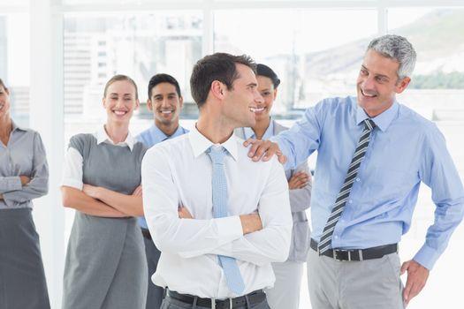 Businessman congratulating his colleagues