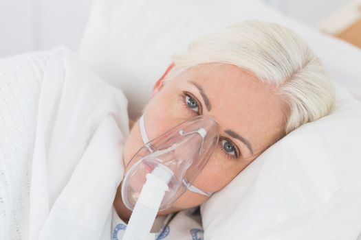 a patient with an oxygen mask