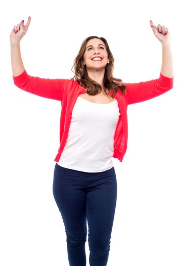 Happy woman celebrating with her arms raised
