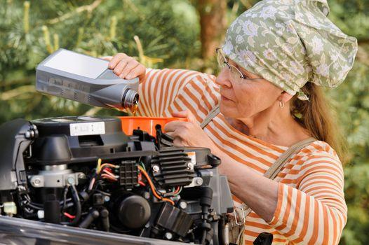 senior woman changing engine oil