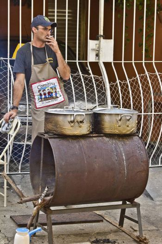 SAO PAULO, BRAZIL - MAY 17, 2015: An unidentified Man make  food at street fair market in Sao Paulo.