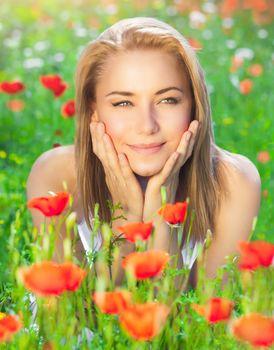 Nice girl on poppy meadow
