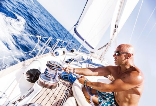 Handsome man working on sailboat