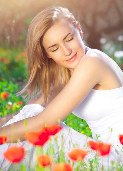 Calm female on poppy field