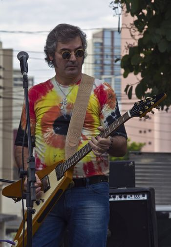 SAO PAULO, BRAZIL - MAY 17, 2015: An unidentified musician playing guitar and singing rock and roll on the street in Sao Paulo, Brazil.
