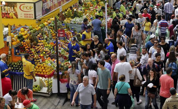 SAO PAULO/BRAZIL - MAY 9: An unidentified vendor at a fruit stand in Central Market of Sao Paulo on May 09, 2015. This landmark is a destination for tourists and locals.
