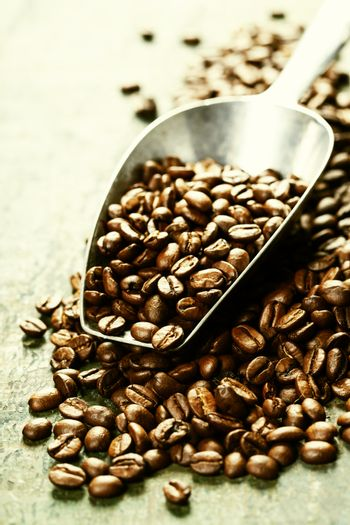 Coffee beans and metal scoop