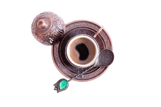 Cup of freshly brewed hot frothy Turkish coffee