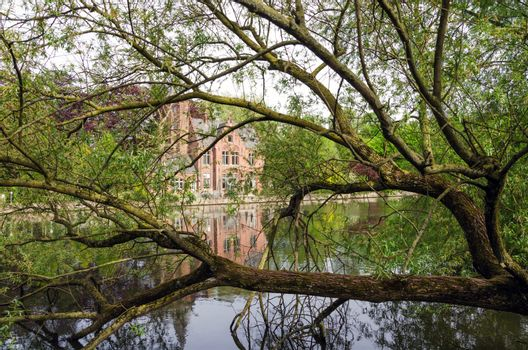 Flemish style building in Minnewater lake, Fairytale scenery in Bruges, Belgium.