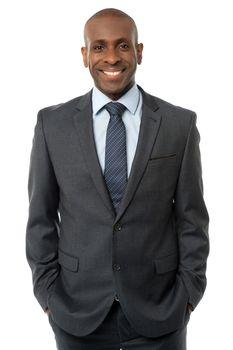 Confident businessman posing
