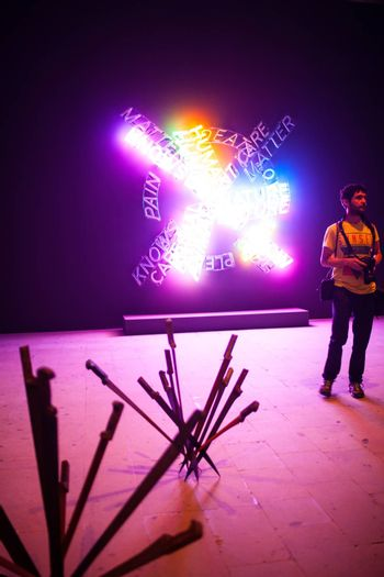 """VENICE, ITALY - MAY 06: View of Bruce Nauman installation intitled """"Human Nature, Life Death, Knows Doesn't Knows, neon"""" showing at Arsenale during the 56th Venice Biennale on May 06, 2015"""