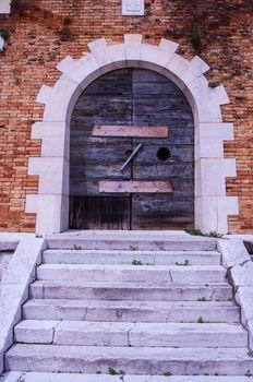 View of old wooden door in Venice