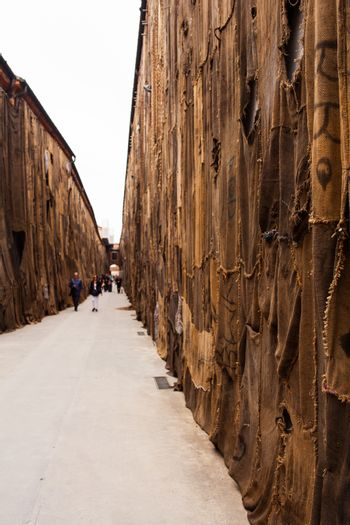 """VENICE, ITALY - MAY 06: View of """"Out of Bounds"""" Ibrahim Mahama site specific installation composed with jute bags and mixed media showing at Arsenale during the 56th Venice Biennale on May 06, 2015"""