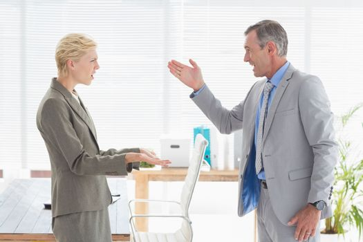 Furious boss yelling at colleague