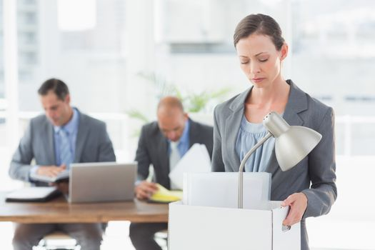 Businesswoman leaving office after being fired