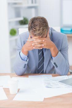 Businessman being depressed by working