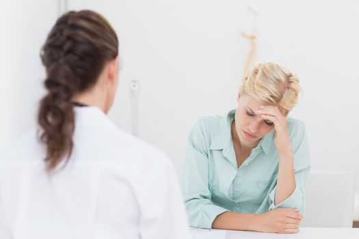 Patient with headache visiting doctor