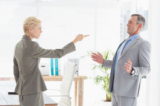 Businesswoman giving out to her boss