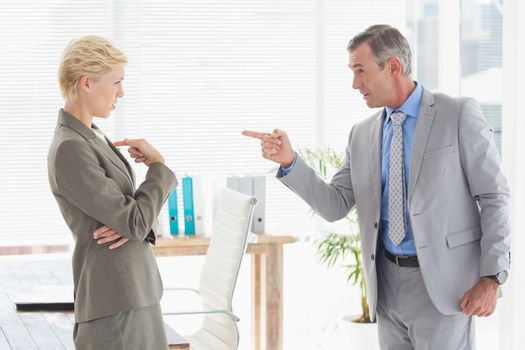 Boss yelling at colleague