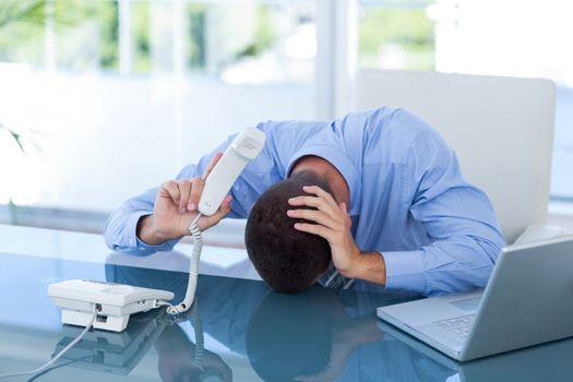 Depressed businessman on the phone
