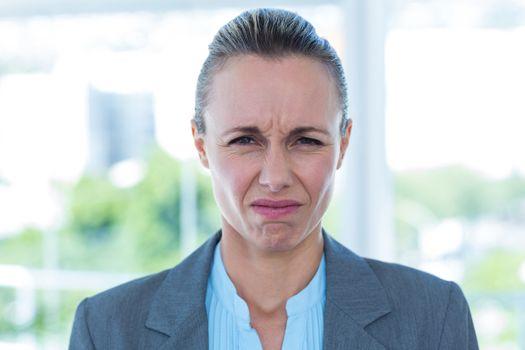 Upset businesswoman in an office