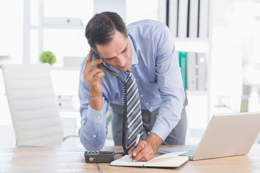 businessman phoning at his desk