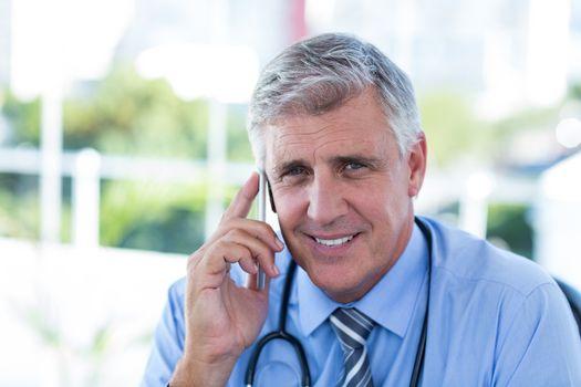 Doctor having phone call