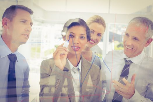 Businesswoman drawing graph on the glass
