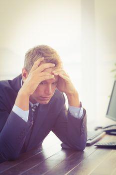 Irritated businessman looking his desk