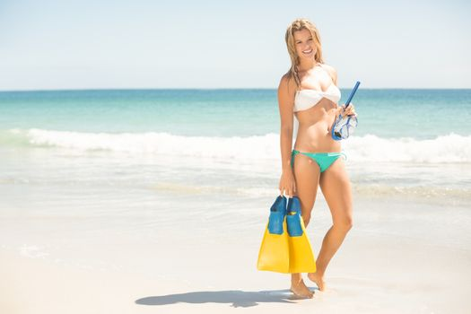 Happy pretty blonde holding mask, scuba and fins