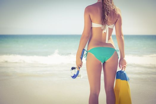 Back turned blonde holding scuba diving gear