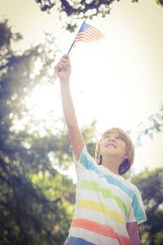 Little boy waving american flag