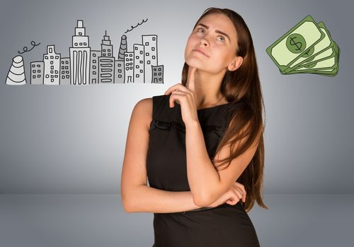 Beautiful business woman thinking over money and buildings. Gray gradient background