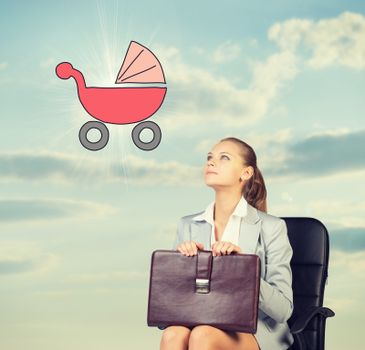 Business woman in skirt, blouse and jacket, sitting on chair imagines buggy. Against background of sky and clouds