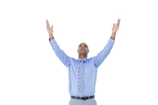 A concentrated businessman with arms up