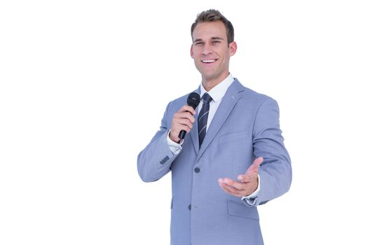 Happy businessman speaking with micro