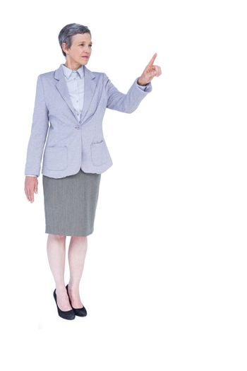 A serious businesswoman with grey hair gesturing