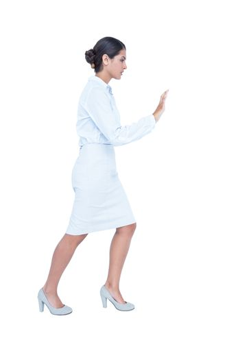 Businesswoman standing and pushing