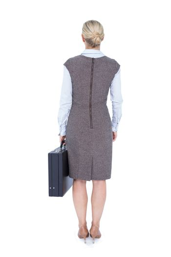 Back turned businesswoman holding a briefcase