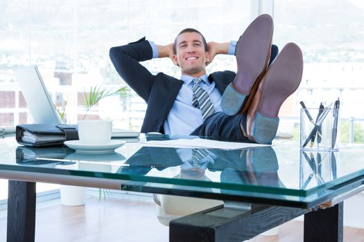 Businessman relaxing in his swivel chair
