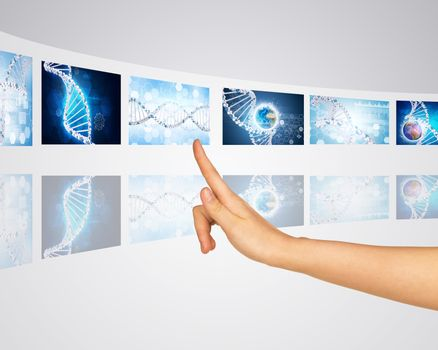 Subject genes earth globe. Finger presses one of virtual screens