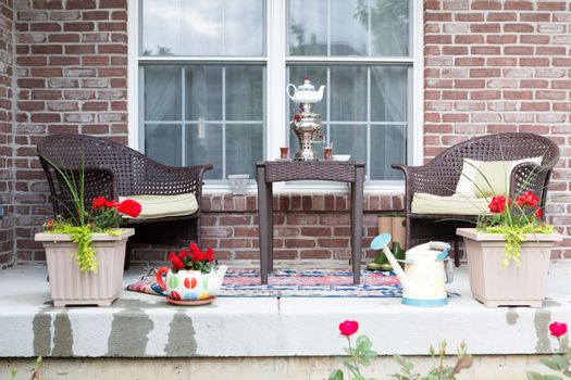 Wicker furniture on the patio with a samovar