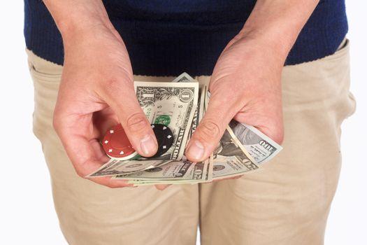 Man Holding Dollar Bills and Casino Chips.
