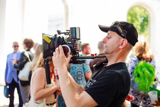 VENICE, ITALY - MAY 06: Cameraman in action during the 56th Venice Biennale on May 06, 2015