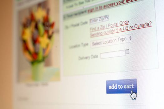 Mouse clicking add to cart button on website