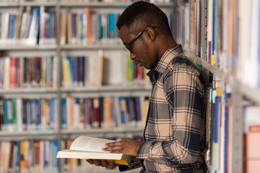 A Portrait Of An Caucasian College Student Man In Library - Shallow Depth Of Field